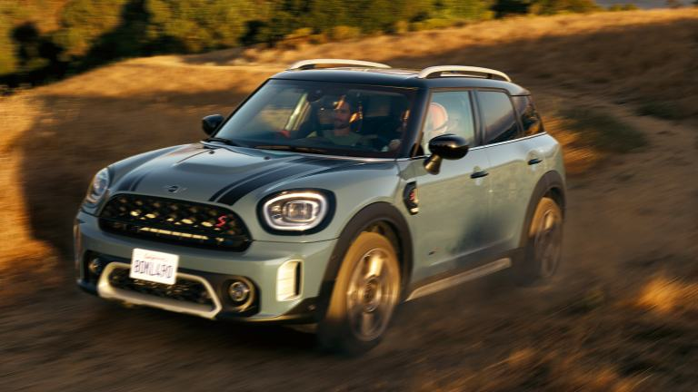 MINI Countryman drives up a mountain road with All4 All-Wheel Drive.